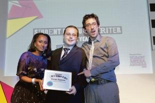 Charles receives his award from the Guardian's Hannah Pool and Radio 5 Live's Colin Murray