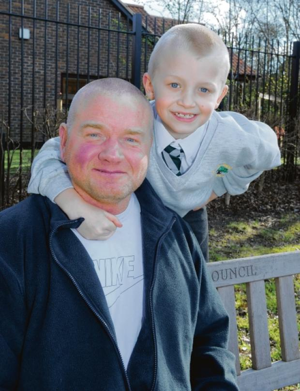 Basildon Recorder: All smiles now           — George with his dad Paul after his brave actions saved his dad's life