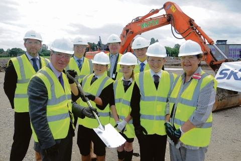 Digging in – Woodlands headteacher Andy White at the groundbreaking ceremony with with pupils, councillors and managers from builder Skanska