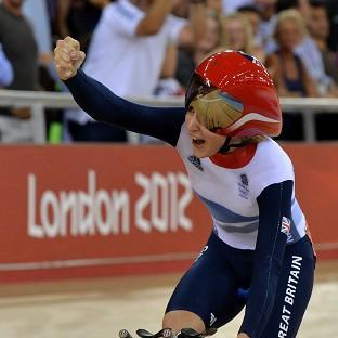Great Britain's Laura Trott celebrates winning gold in the women's omnium at the Velodrome in London