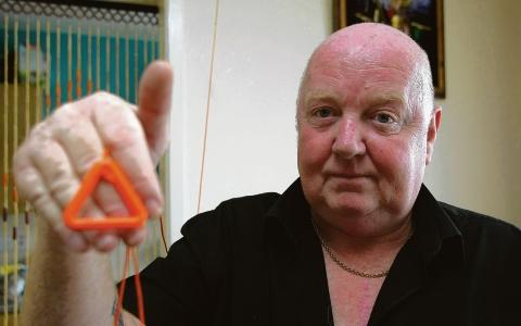 Neighbour Norman Battersby displays a help cord which is in all the flats