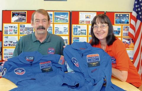 Out of this world – Ken and Jane Lewis with their NASA space camp uniforms