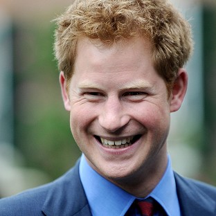 The Sun has become the first British newspaper to publish photos of Prince Harry naked
