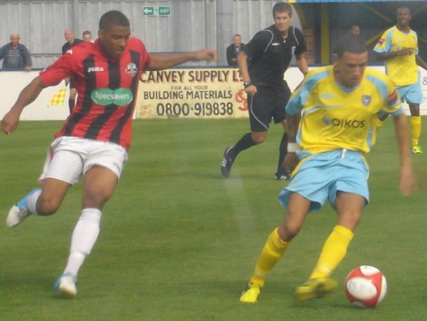 Lewes captain Steve Robinson closes down Canvey's Ashley Dumas.