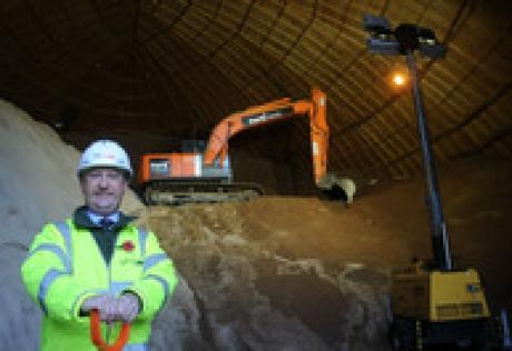 Derrick Louis, county councillor responsible for highways and transportation, by the gritting salt at a depot in Chelmsford