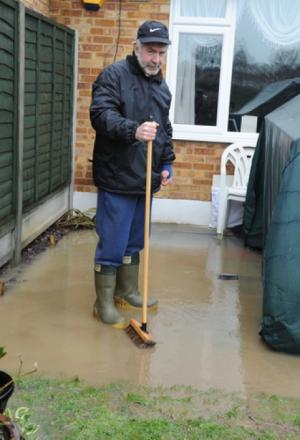 Tony Kimmins has been sweeping water away from his house