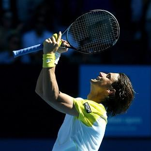 David Ferrer looks to the sky after overcoming a two-set deficit to progress (AP)
