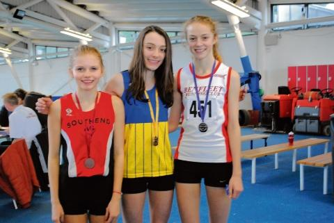 Lucy Kidwell, Isobel Ives and Victoria Hiscock on the podium for the under-17 girls 1,500m