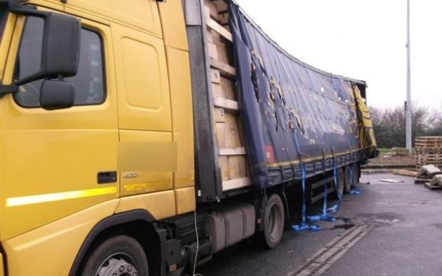Leaning load of jeans impounded on lorry