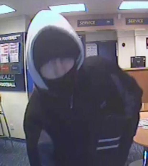 CCTV of betting shop knife robber released