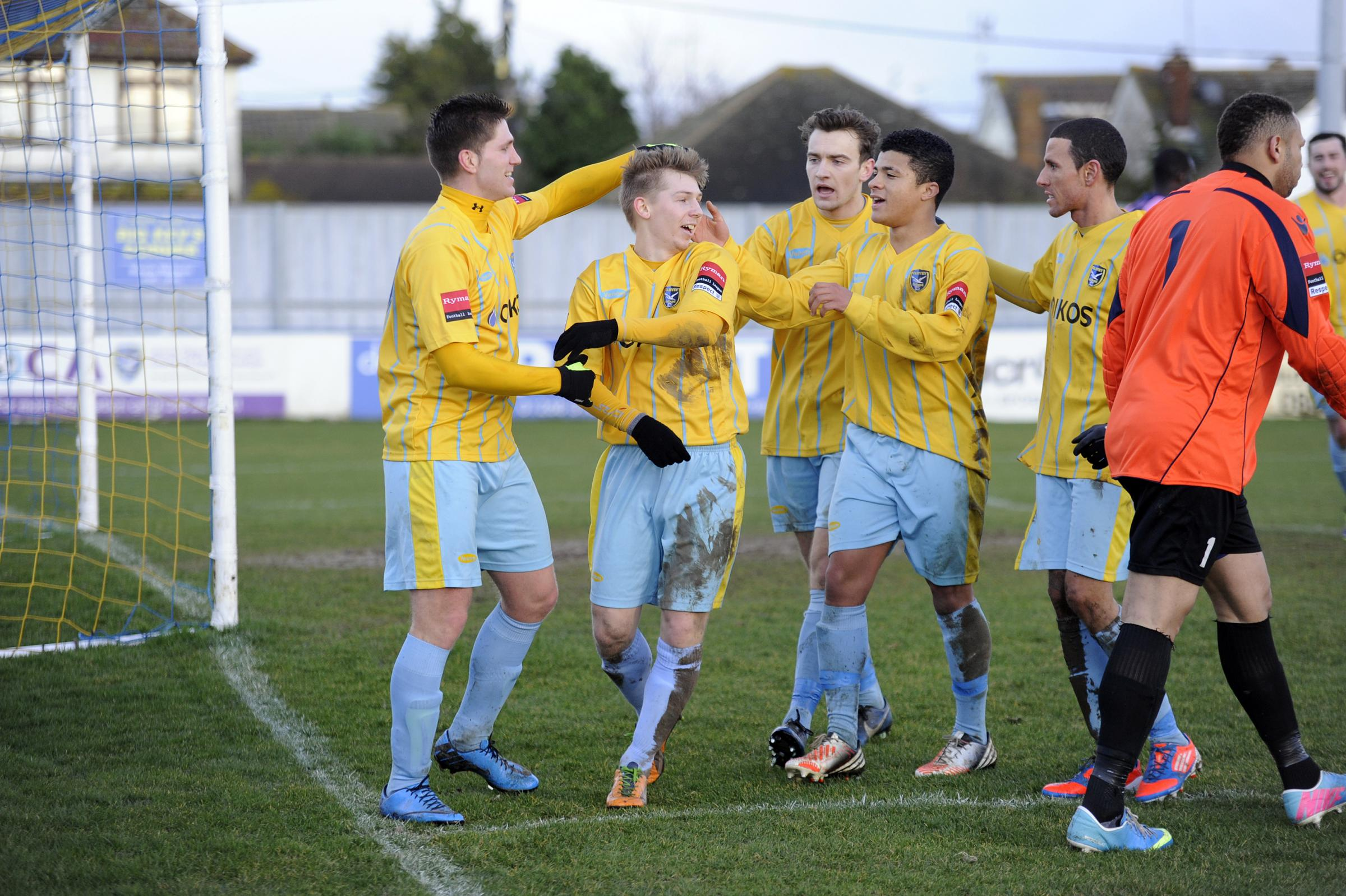 Celebrating the winner – Harrison Chatting is mobbed by his team-mates after giving Canvey the lead