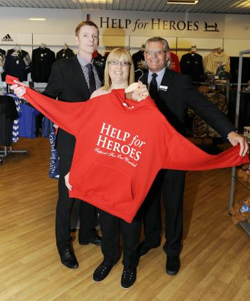 Open for business – sales managers Alan Workman and Andy Trace with Tracie Davey, Help for Heroes' concession supervisor