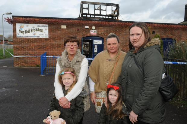 Waiting for news – managers Tracey Hill and Donna Surridge with Donna Locke (right) and her daughters, Paige, six and Chloe Halls, four