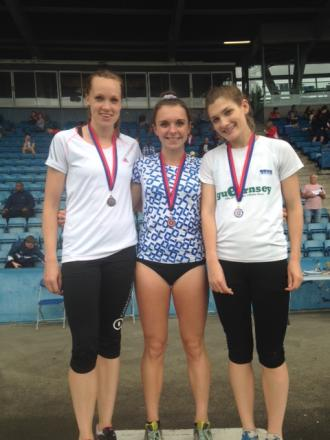 Gemma Kersey (centre) with her gold medal at the Southern Championships