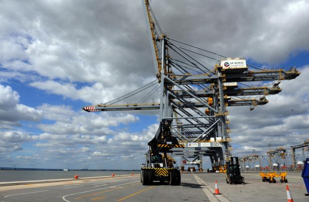 A grab reacher moves beneath London Gateway's giant quay cranes