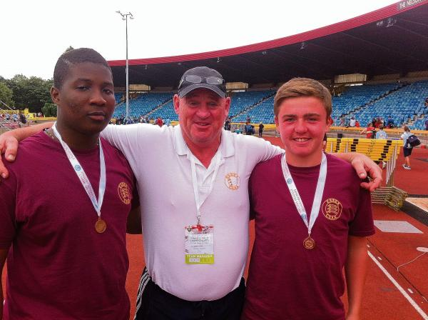 Castle View PE teacher Dick Gibbons with Victor Adebiyi (left) and Levi Causton