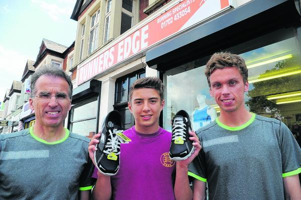 Michael Shields, centre, with Mike and Paul Whittaker from Runner's Edge and his new Skechers trainers