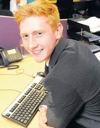 Loving his work – Alex Dray, is an apprentice at Southend property firm Regis