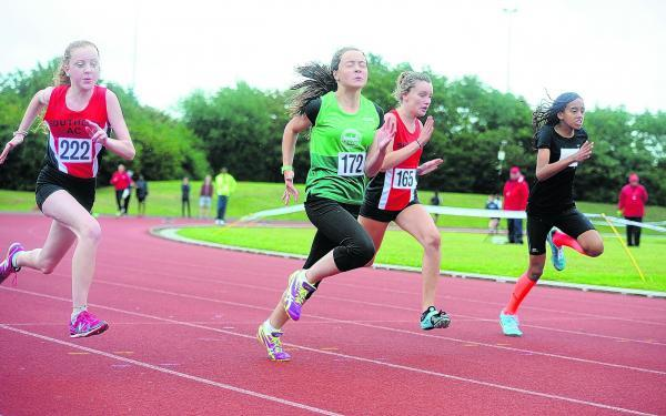 Eva King (222) and Katie Judd (165) race in the under-15 girls 100m race