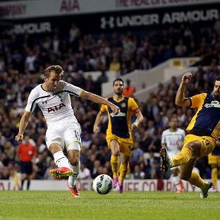 Harry Kane, left, scores Spurs' first goal, on what was an eventful night for him