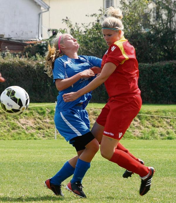 Hannah Porter (red) clashes in midfield